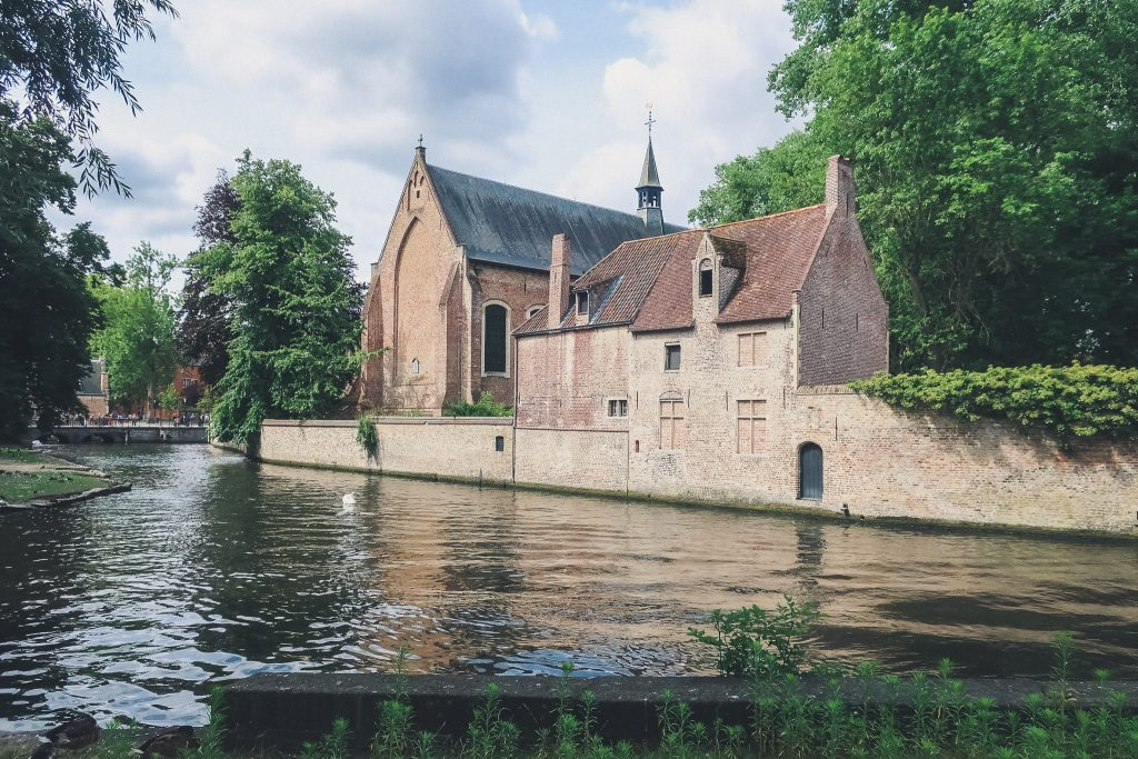 romantic castle building on the lake of love in bruges