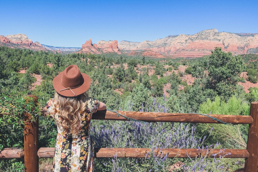 Girl looks out at Sedona Red Rocks from Mariposa Grill