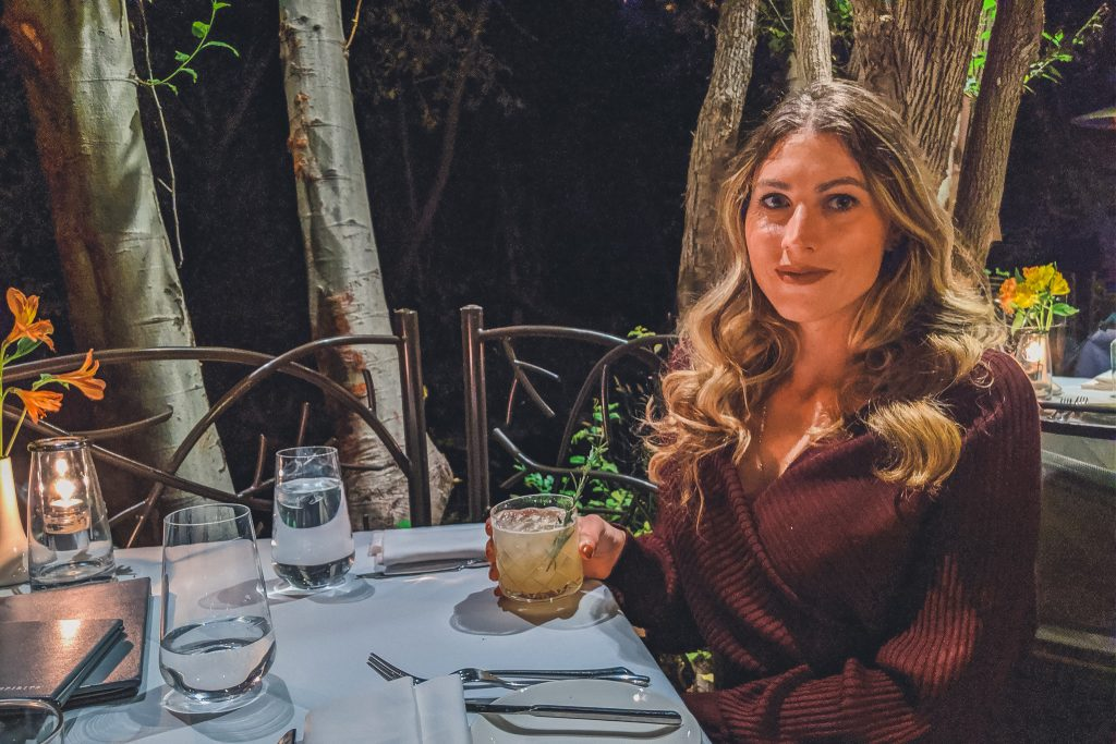 Girl dines at Cress on the Creek in L'auberge de Sedona