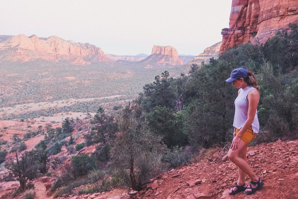 Girl hikes along Sedona trail at sunset