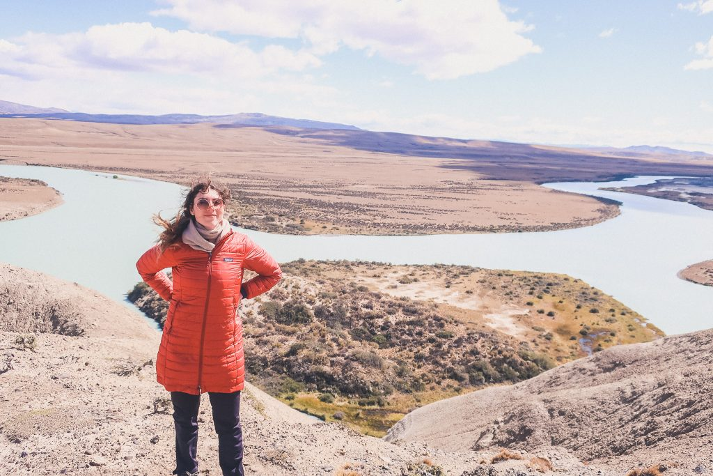 woman wears compressible jacket at la leona petrified forest