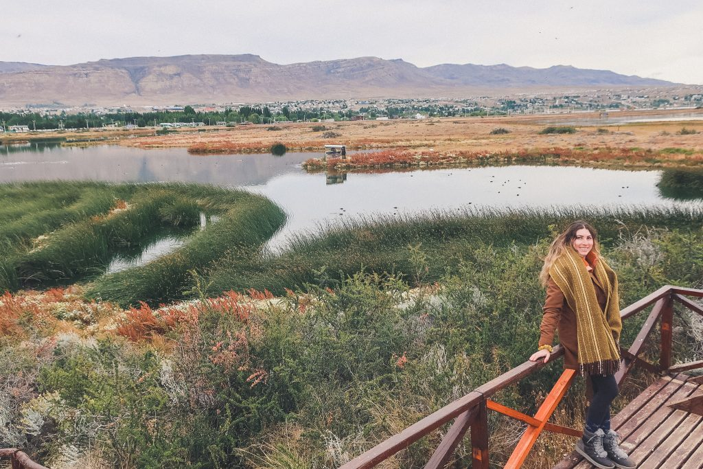 girl explores Laguna Nimez Reserve wearing wool blanket scarf