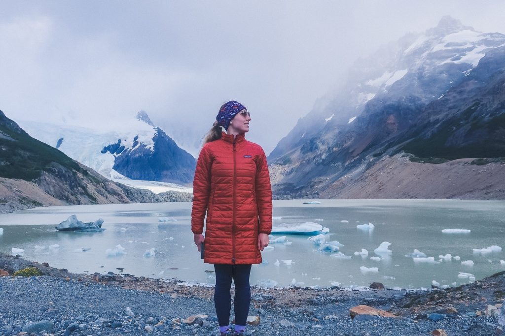 woman wears compressible jacket and thermal headband in Patagonia