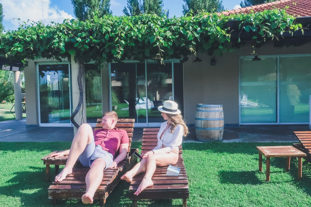 couple relaxing a Villa Mansa in Lujan de Cuyo