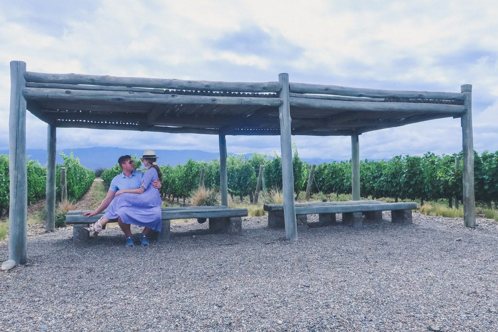 couple sits in vineyards in Uco Valley