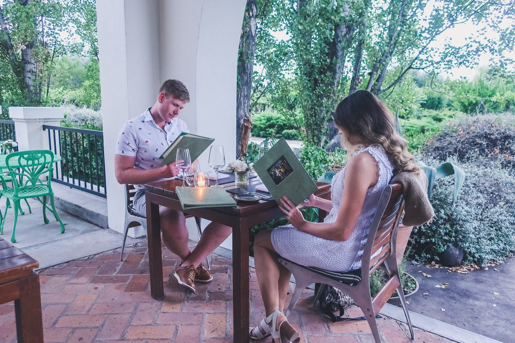 couple eats dinner at Cavas Wine Lodge