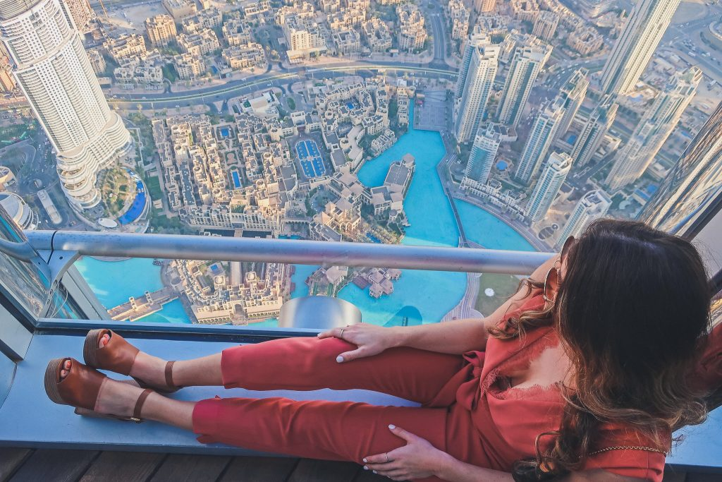 woman in Burj Khalifa wears a pink jumpsuit