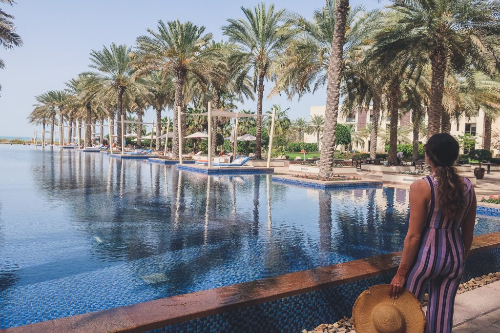 woman wears jumpsuit to pool in Abu Dhabi