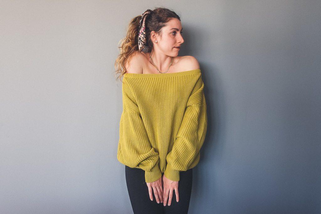 woman wears oversized knit sweater