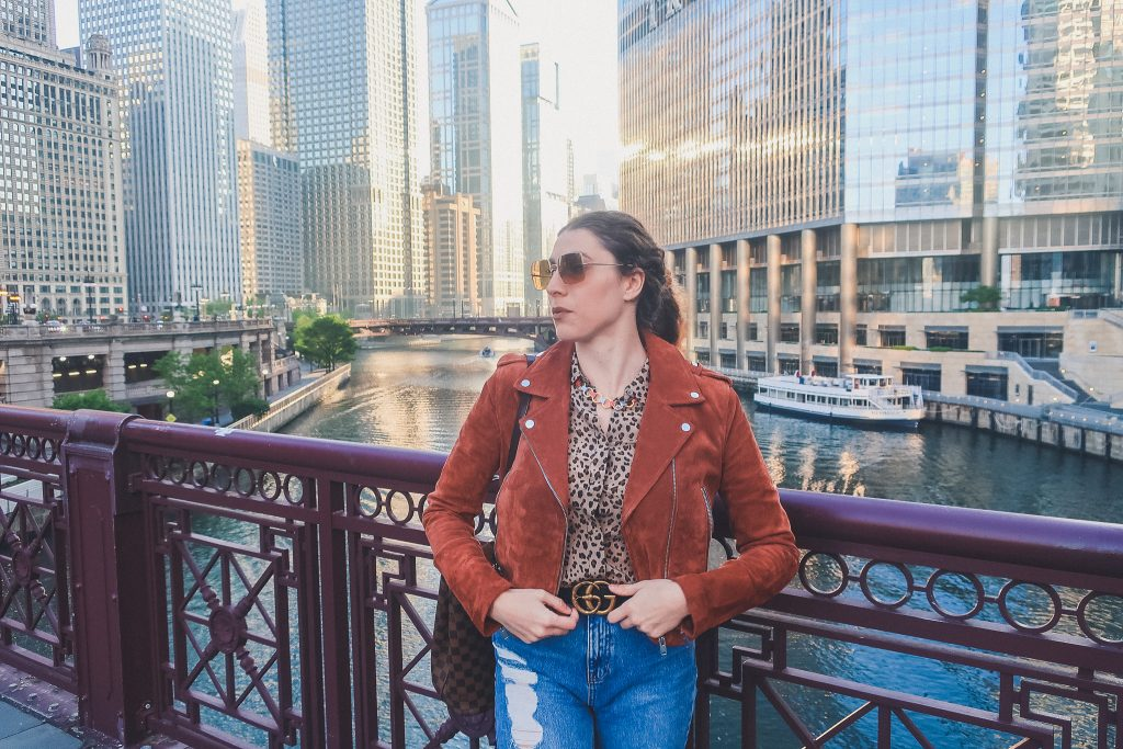 woman in Chicago wears suede jacket