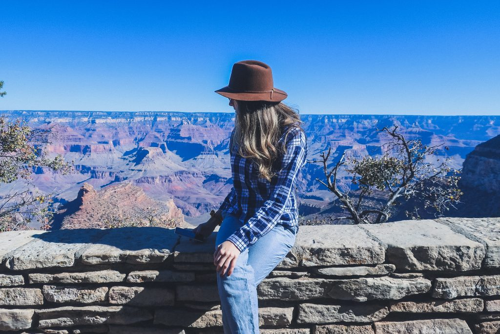 woman wears blue plaid shirt at the grand canyon