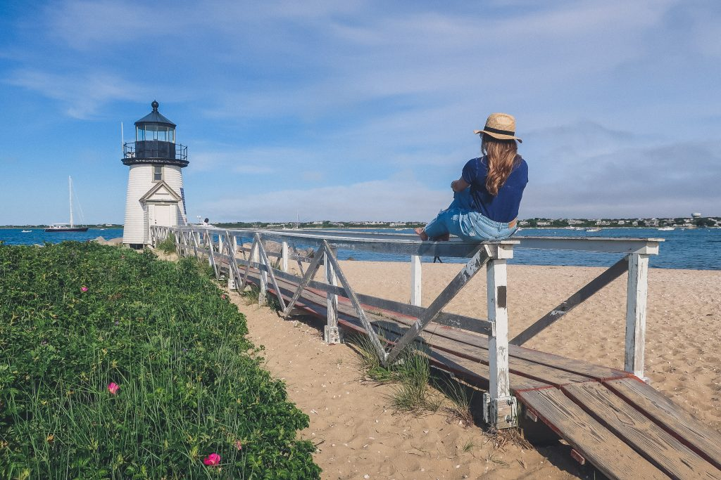 woman at Brant Point lighthouse in Nantucket