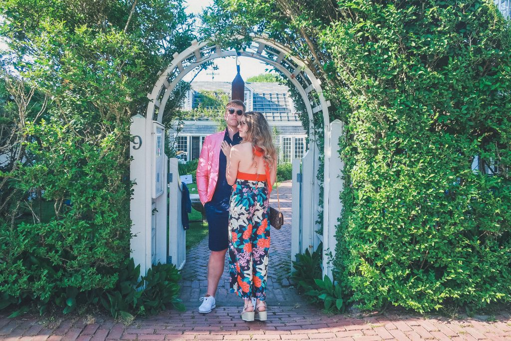 couple stands outside the garden at the The Chanticleer Nantucket