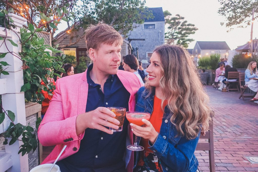 couple says cheers with drinks at Cru Nantucket