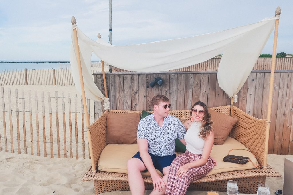 couple sits relaxing at Gallery Beach Restaurant in Nantucket