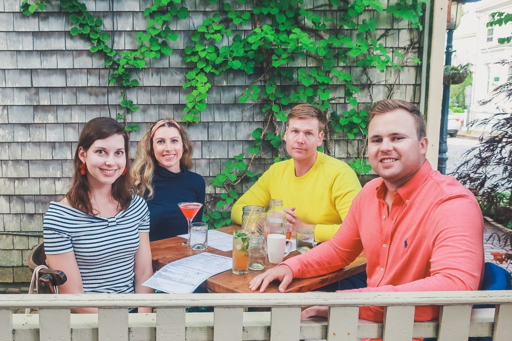 group of friends dines at the Proprietors Bar & Table in Nantucket