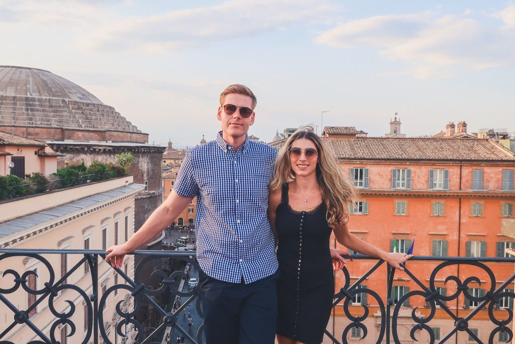 couple at a rooftop bar in rome