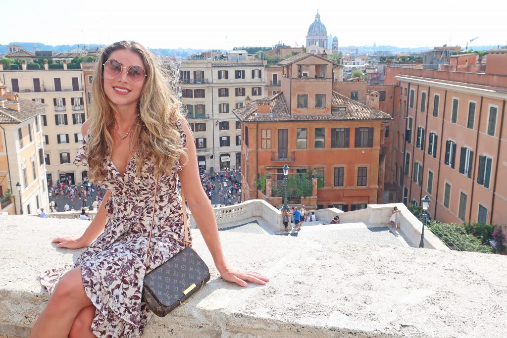 woman stands on spanish steps top