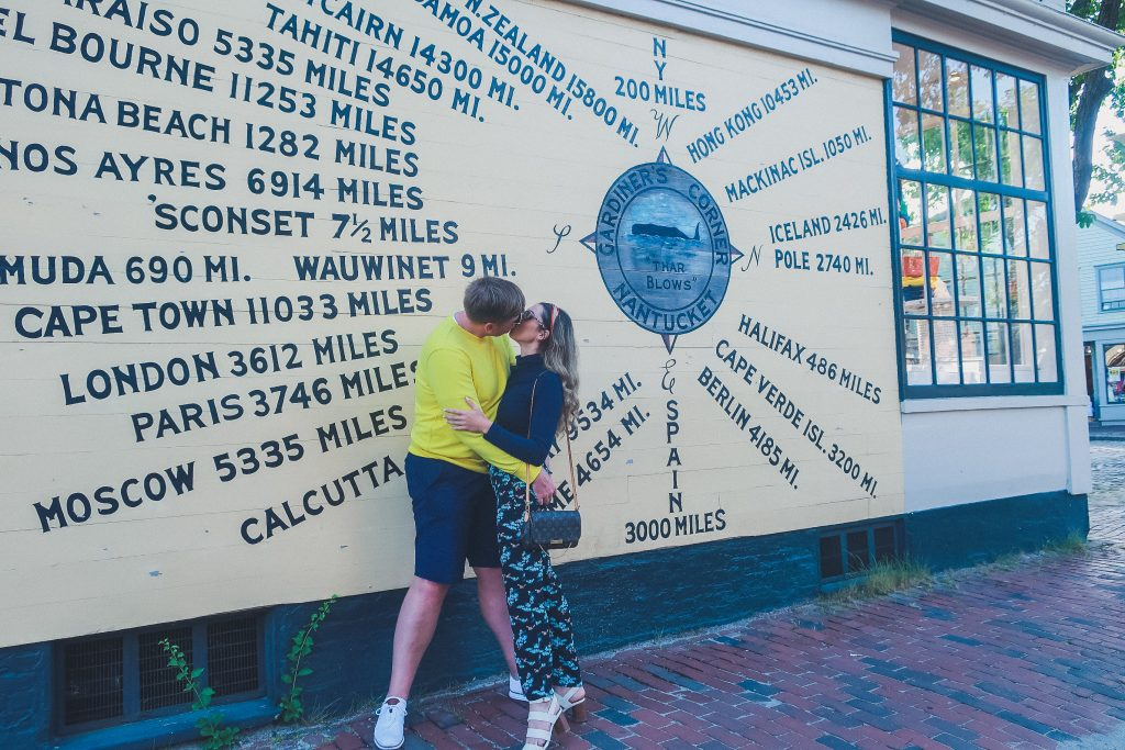 couple kisses at compass rose in Nantucket