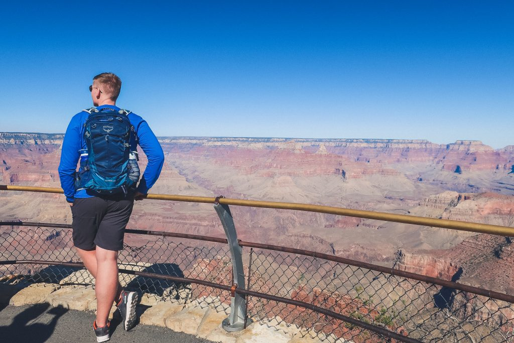 man wears backpack at the grand canyon