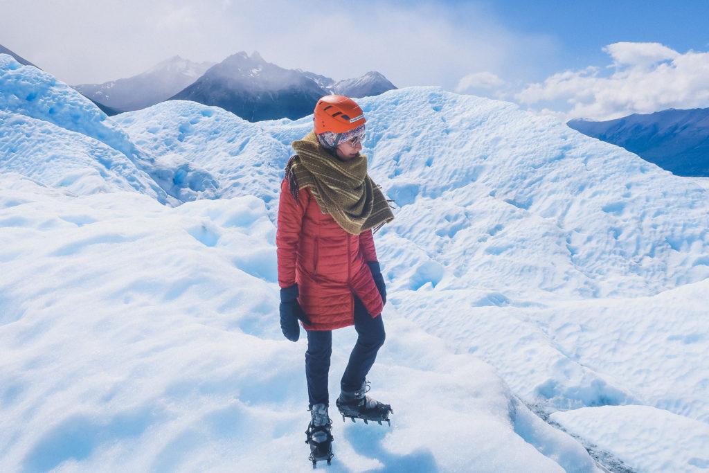 woman treks across the Perito Moreno glacier, very snowy conditions