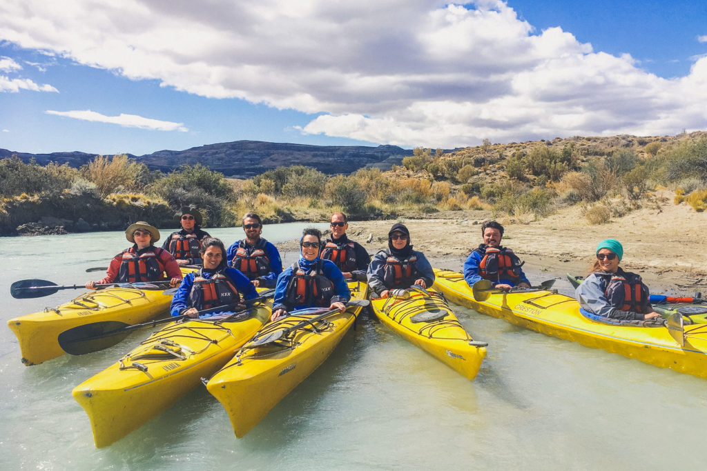 group of kayakers planning to visit La Leona Petrified Forest