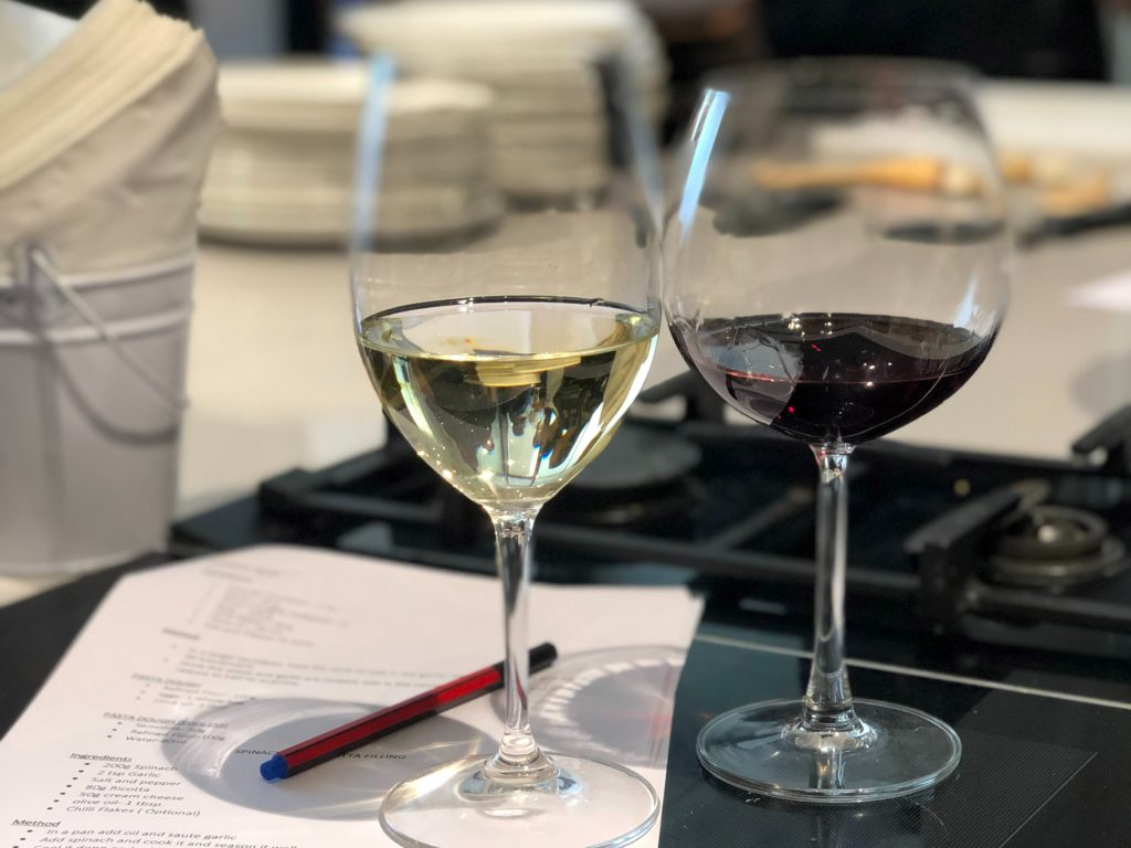 Italian cooking class, 2 glasses of wine on a printed out note sheet