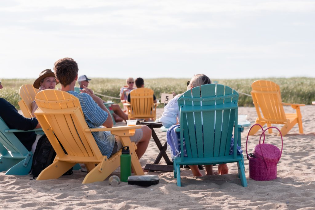 family relaxing on a beach in New England
