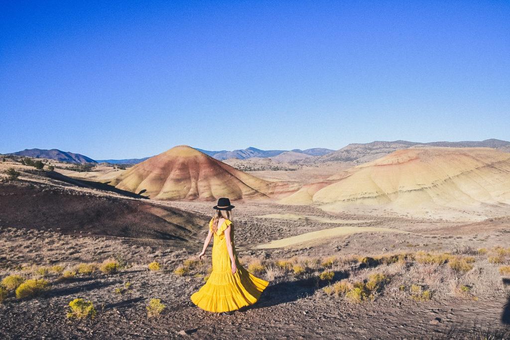woman walking through Painted Hills Oregon