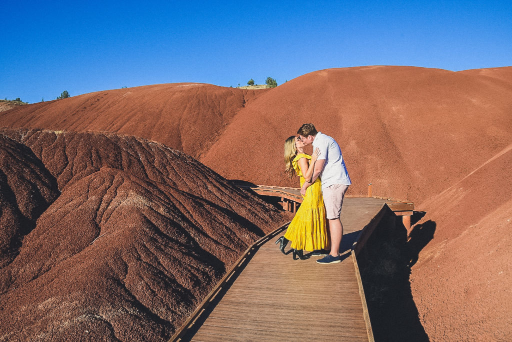 couple kisses at Painted Hills, Oregon