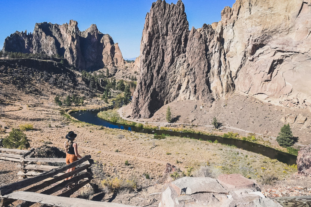 woman looks at panorama of Smith Rock State Park